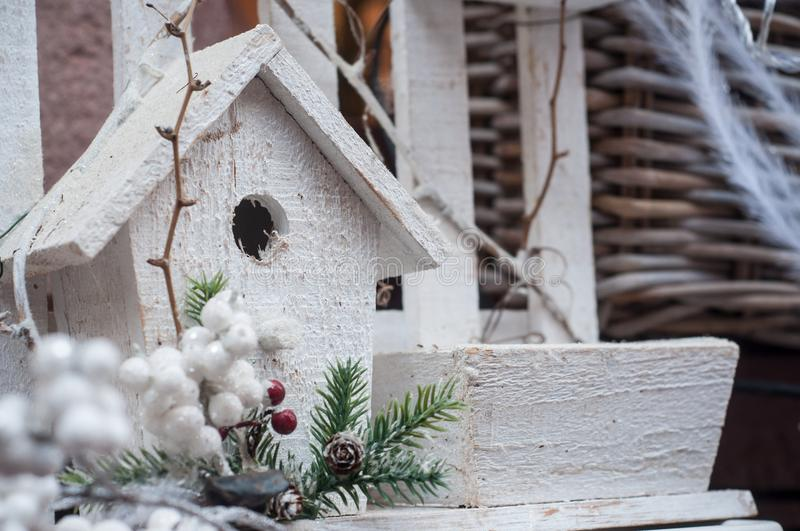 White decorative birdhouse for christmas decoration stock photo