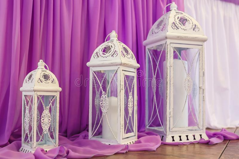 White decorative wooden latern lights in expensive interior with violet background royalty free stock photos