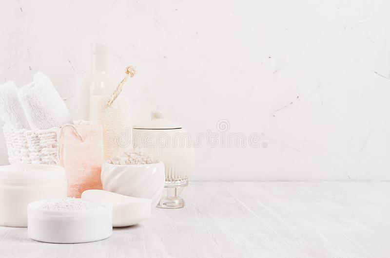 White delicate cosmetics products for body and skin care in white modern bathroom on shelf, copy space. White delicate cosmetics products for body and skin care stock photos