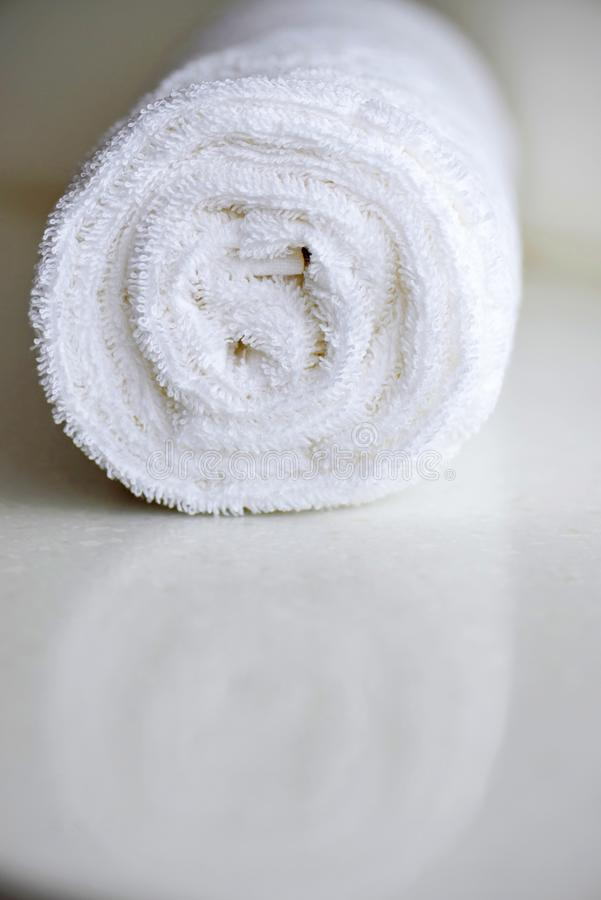 White delicate soft background of fur plush smooth fabric. Clean white towel rolled blanket textile. Concept spa, backdrop, bathrobe, beige, carpet, cloth stock photo