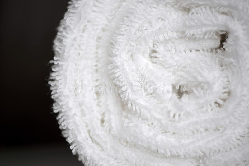 White delicate soft background of fur plush smooth fabric. Clean white towel rolled blanket textile. Concept spa, backdrop, bathrobe, beige, carpet, cloth stock images