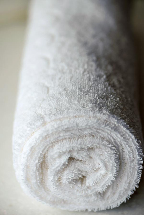 White delicate soft background of fur plush smooth fabric. Clean white towel rolled blanket textile. Concept spa, backdrop, bathrobe, beige, carpet, cloth royalty free stock photography
