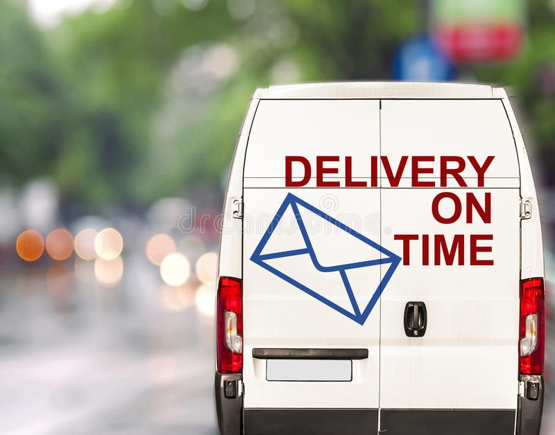 White delivery on time Van driving fast on city blurr bokeh. Street stock photography