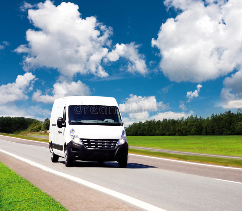 White delivery van stock photography