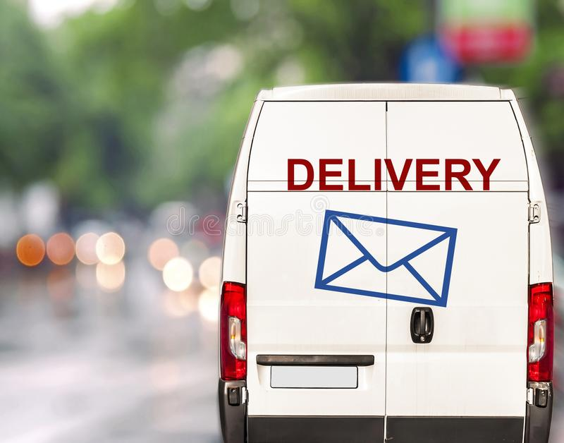 White delivery Van driving fast on city blurr bokeh street. Close stock photos
