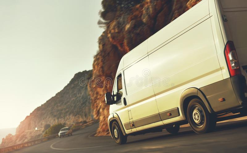 Delivery van on countryside road on sunset royalty free stock photography