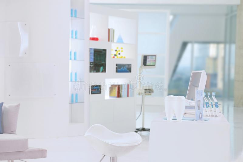 White dental clinic. A reception table of dental clinic put in a modern white buiding stock photos