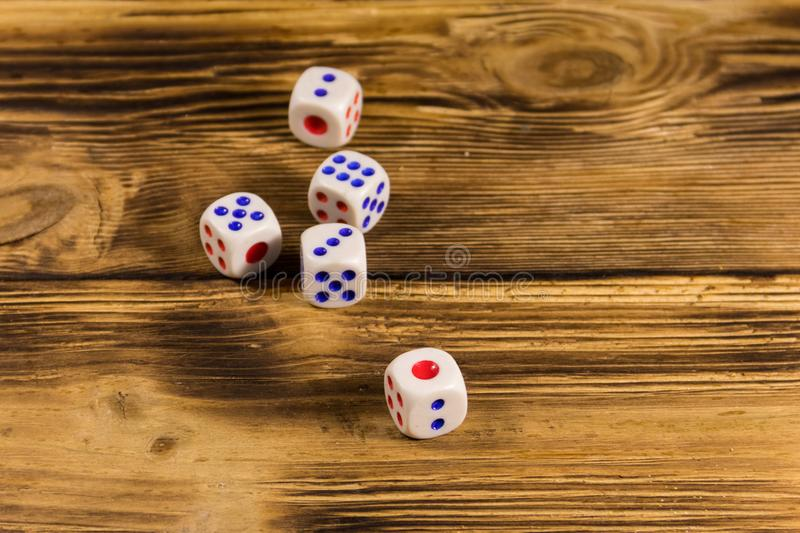 White dice on wooden table. Game of chance concept stock images