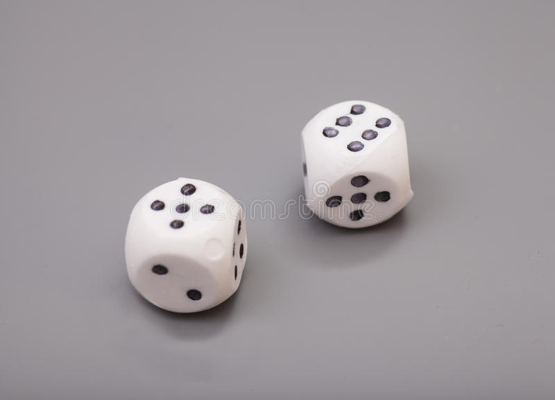 White dices. On grey background stock photos