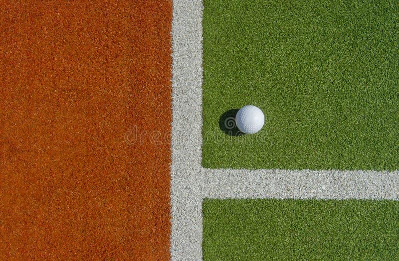 White dimple hockey ball on astro turf.  royalty free stock photos