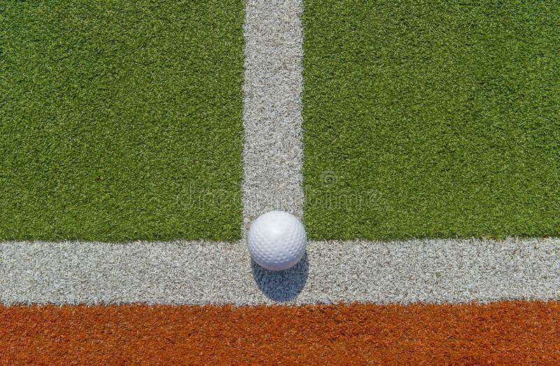 White dimple hockey ball on astro turf.  royalty free stock photo
