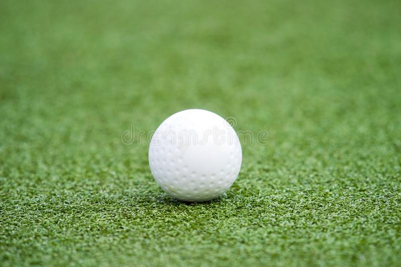 White dimple hockey ball on astro turf.  royalty free stock photography