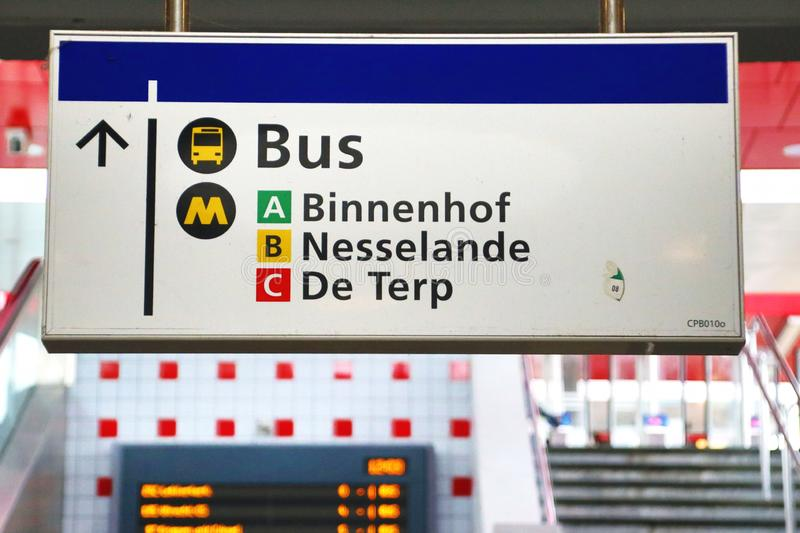 White  direction sign at the metro station Capelsebrug in Rotterdam. stock photo