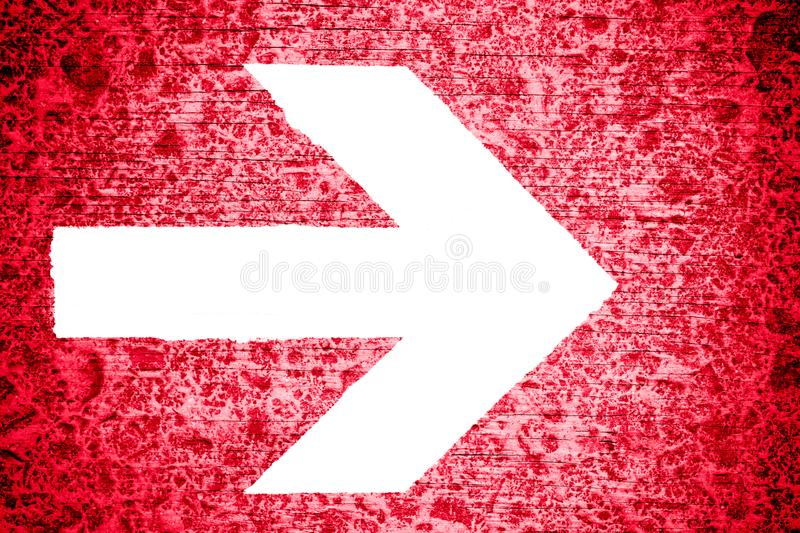 White directional arrow pointing towards right painted on a bright red grungy irregular wooden texture background royalty free illustration