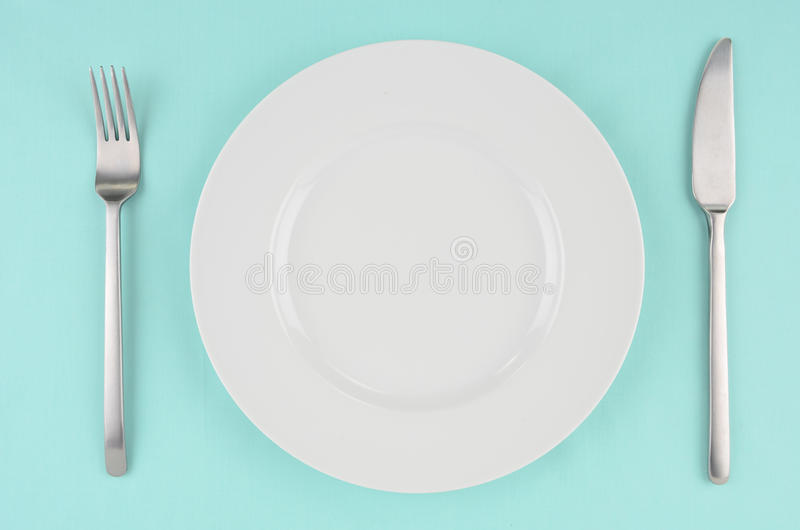 Download White Dishes On Aqua Tablecloth Stock Photo - Image: 28777996