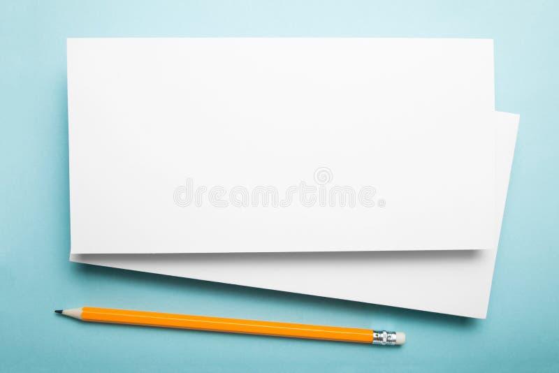 White DL Flyer Mock-Up on blue background.  royalty free stock images