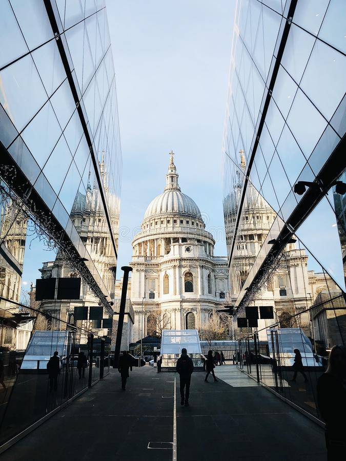 White Dome Cathedral in Between Curtain Wall Building at Daytime royalty free stock photography