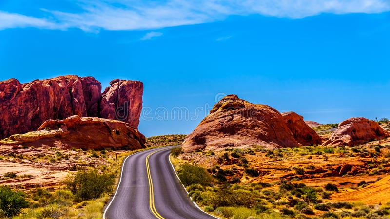 The White Dome Road winding through the Red Sandstone Rock Formations in the Valley of Fire. State Park in Nevada, USA royalty free stock photos