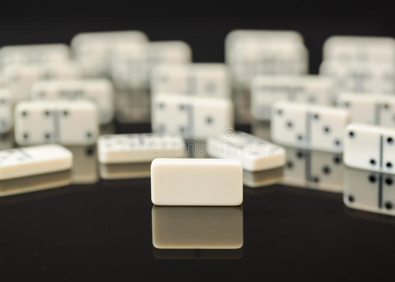 White dominoes with single blank domino royalty free stock photography