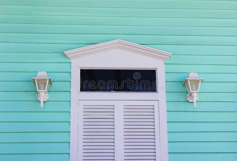 White Door with Aqua Siding stock image