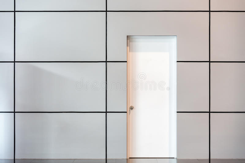 White door. Inside a modern building royalty free stock images