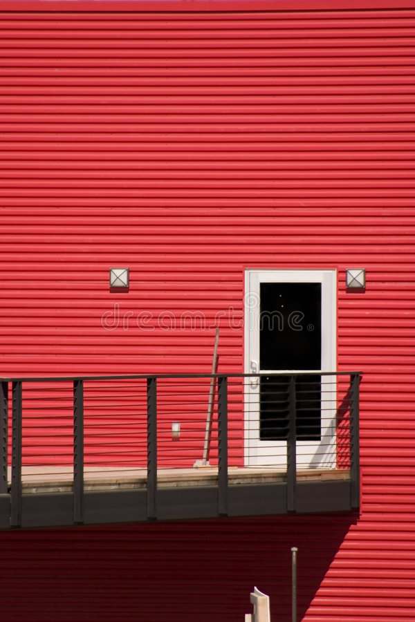 White Door with Red Walls. White Door with Red Siding Walls and the Patio royalty free stock photos