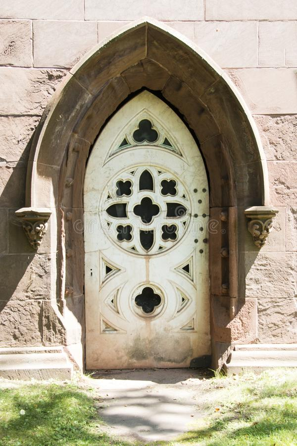 White door on the side of a church stock images