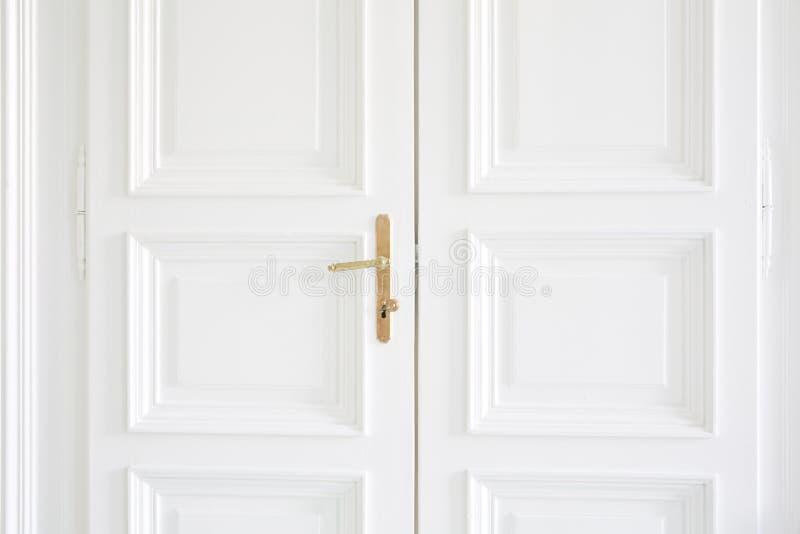 White Doors With Golden Handle Inside Stock Photo