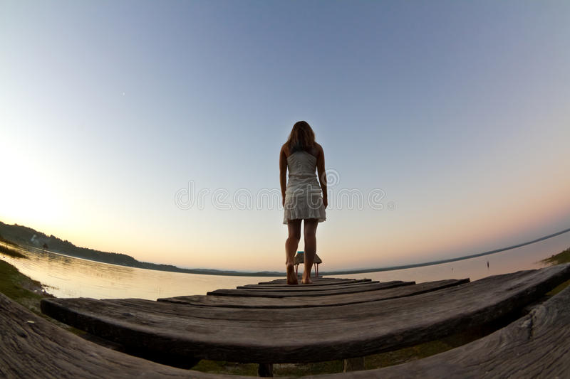 White dress against a beautiful sunrise royalty free stock images