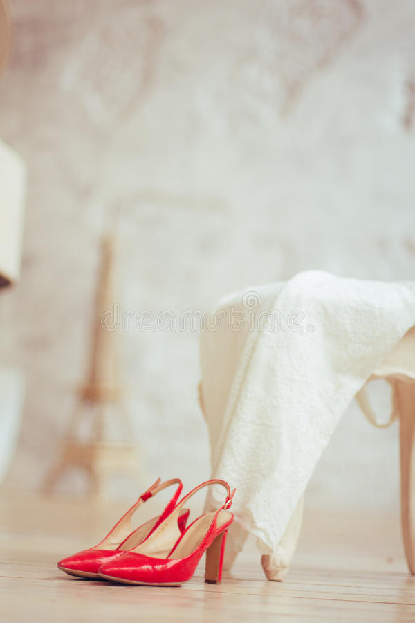 White dress and red shoes stock photography