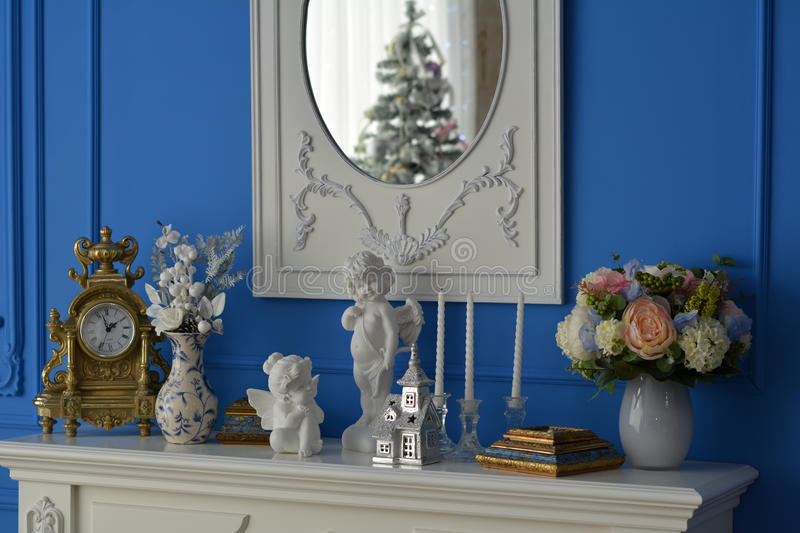 White dresser with mirror reflecting the tree royalty free stock photo