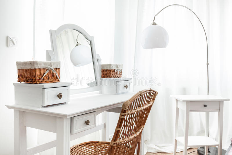 White dressing table with wicker elements royalty free stock photo