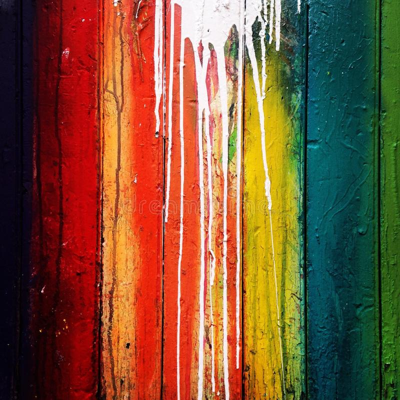 White drips on colorful wall stock photography