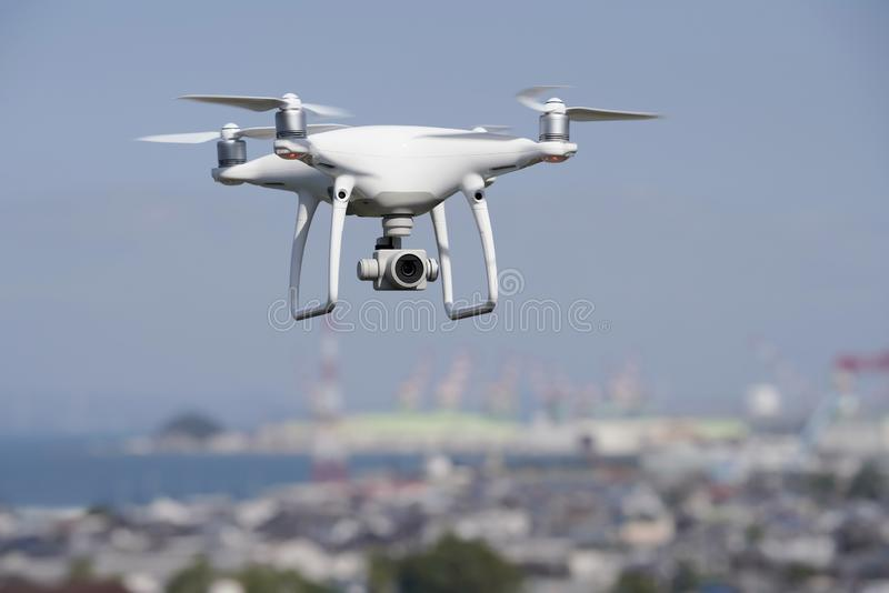 White drone flying over the city stock image