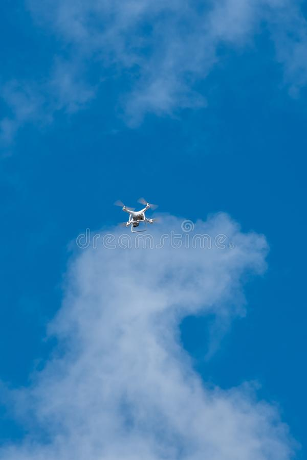 white drone hovering in a bright blue sky, Radio control helicopter with camera stock photos