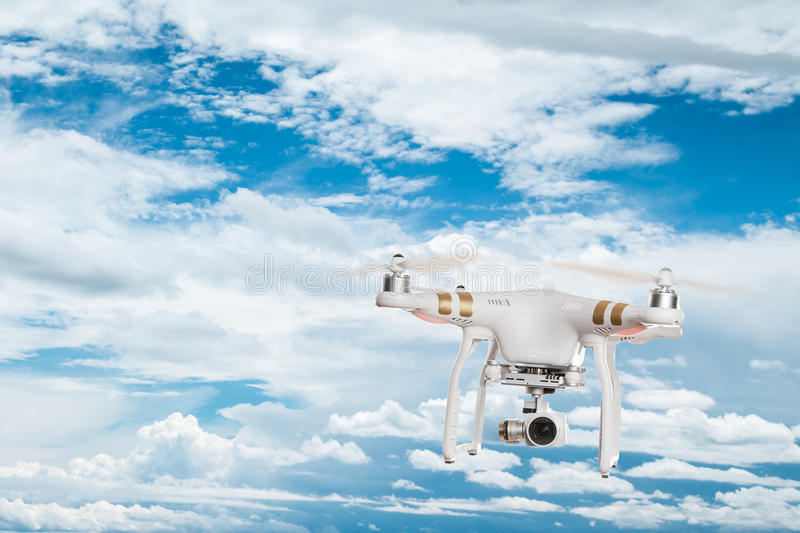 White drone quad copter with 4K digital camera flying. stock photos