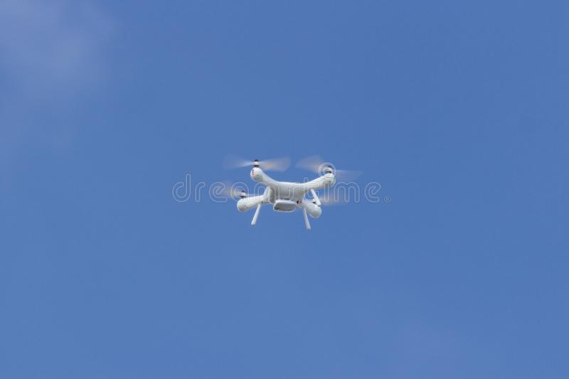 White drone in the sky royalty free stock photography