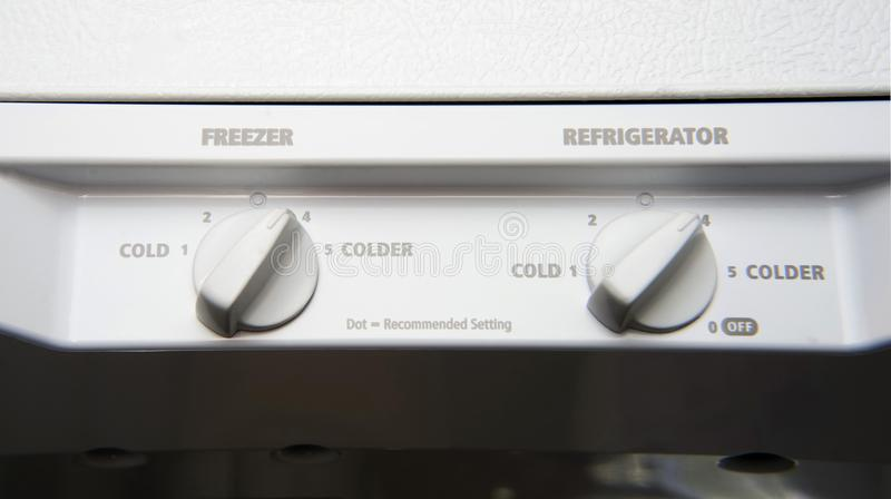 White dual thermostat inside refrigerator. White dual thermostat for freezer and refrigerator stock photography