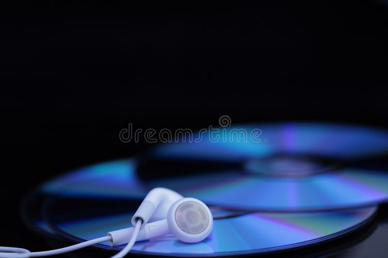 Download White ear phones on CDs stock image. Image of phones - 22031293