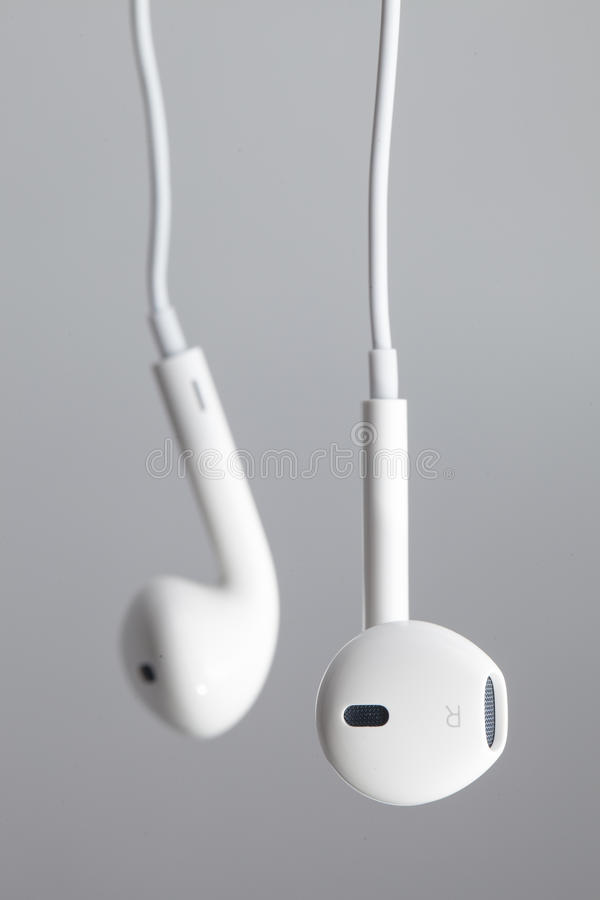 White earphone. On gray background stock photo