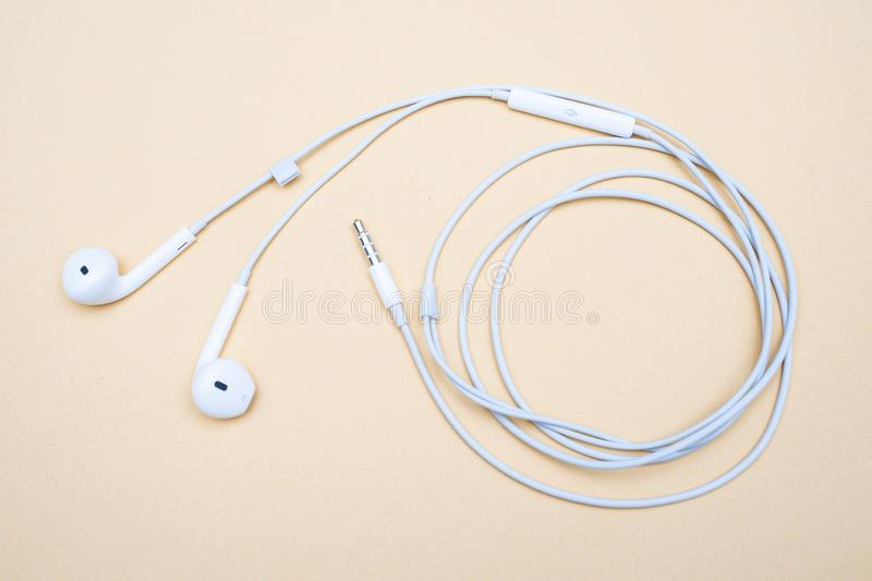 White earphone for use with smartphone royalty free stock photo