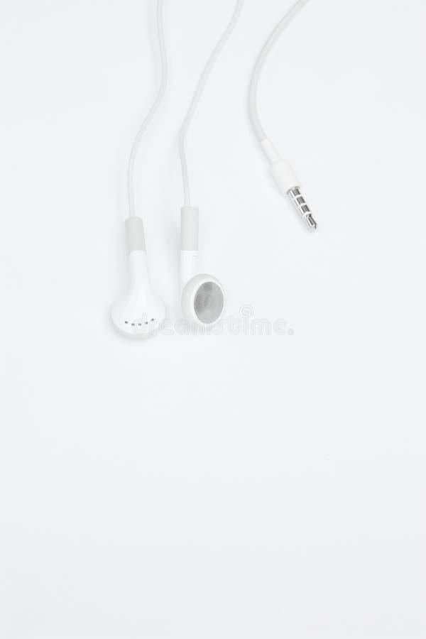 White earphones royalty free stock image