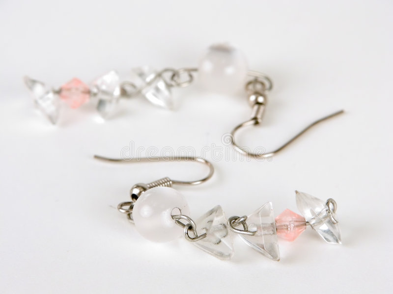 White earring. Against white background stock images