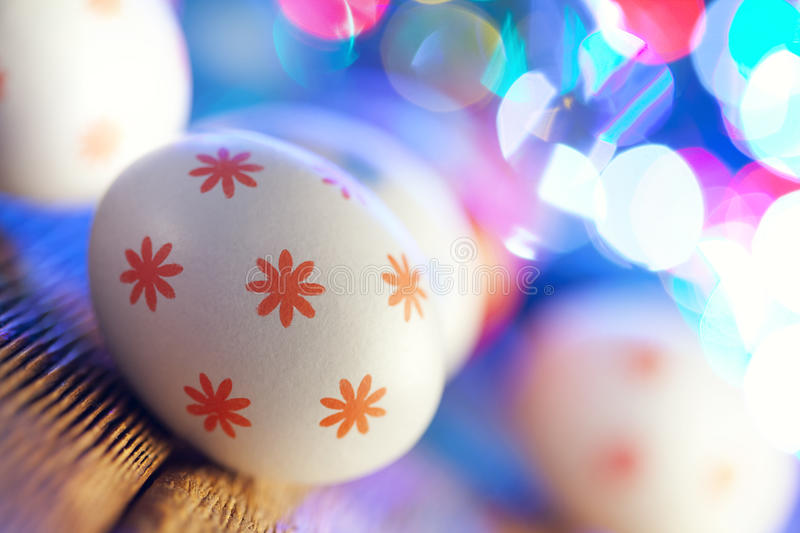 White Easter eggs on lighting background royalty free stock photography