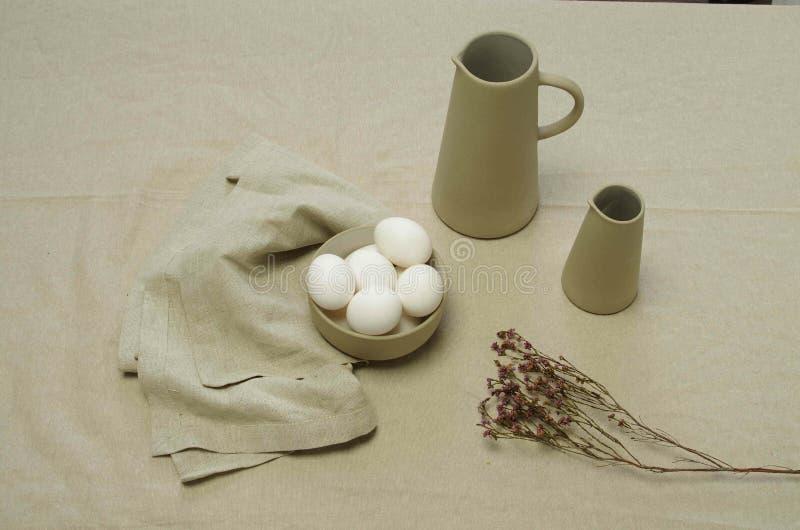White eggs and jars stock photos
