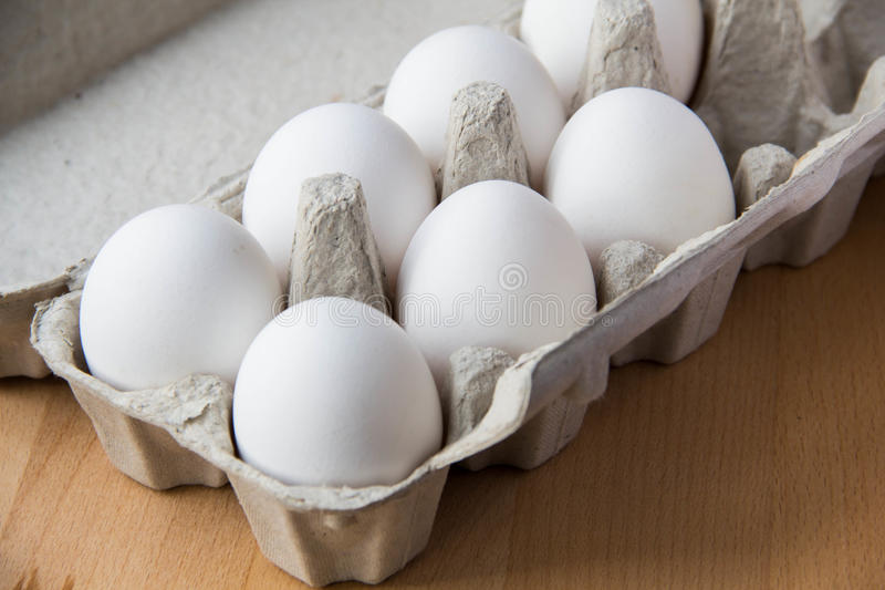 White eggs in box. A few white eggs in box for breakfast royalty free stock photos