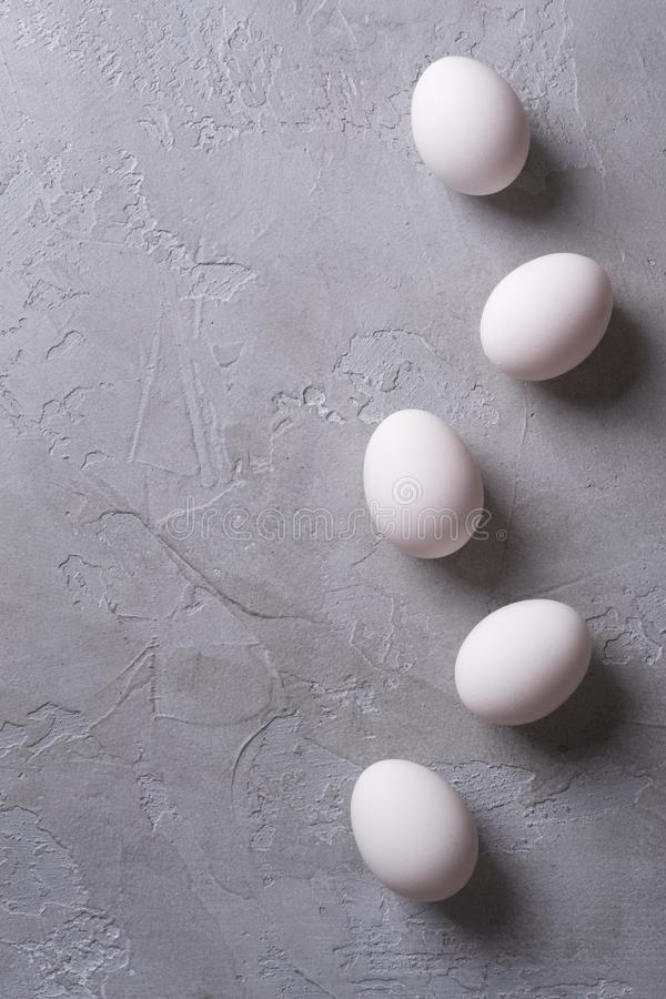 White eggs on a gray concrete table. Easter photo concept. royalty free stock images