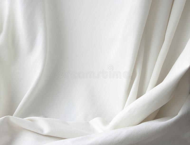 White elegant canvas cloth texture drapery background. Backdrop for studio photography royalty free stock photo