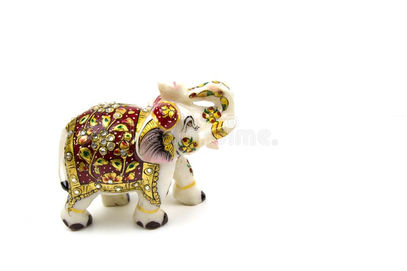 White elephant marble figurine with red and gold painting isolated on white background stock photography