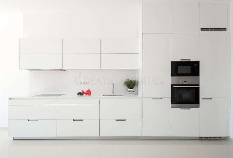 White empty classic kitchen in front view. Kitchen appliances. royalty free stock photography
